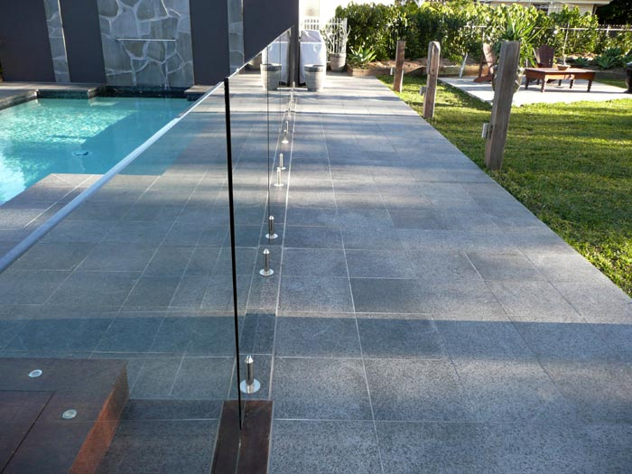 Black Granite Tiles Used As Pool Surrounds