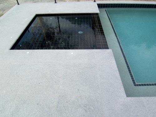 Paver Tile Light Grey Granite Stone pool pavers surround this pool