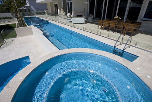Travertine linen natural stone used as pool tiles and coping for Natural stone around pool
