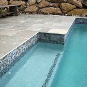 Grey Gum Quartzite Pool Pavers and Rounded Square Coping