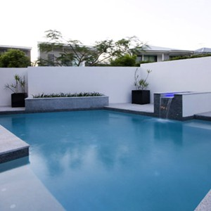 Light Grey Granite Pool Pavers Evening photo