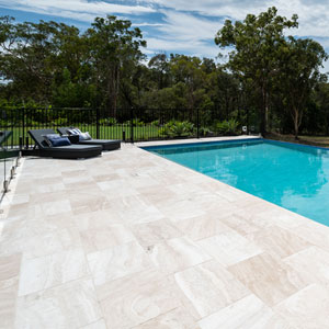 Ivory Travertine used as coping and surrounds of the tile