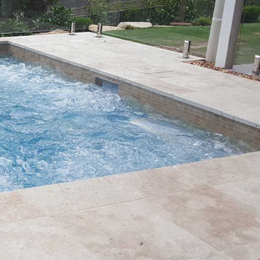 install bullnose pavers around pool - with the coping installed it