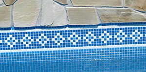 Lake Como Mid Blue Waterline tiles shown tiled in a swimming pool