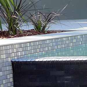 Snow Blend glass mosaics used on a fully tiled pool interior with startling results