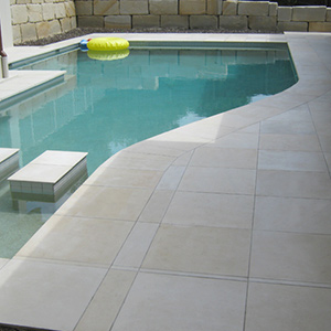Honed Himalayan Sandstone Pool Tile in place