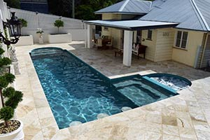 Travertine Coffee Swirl stone tiles used for pool paving