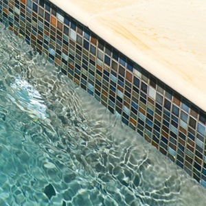 Cuban blend ceramic mosaic pool tiles in place