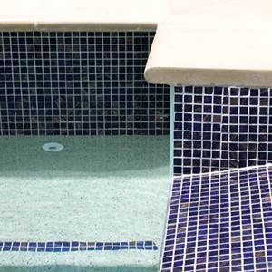 GC125 Dark Blue Gold glass mosaic pool tiles in place