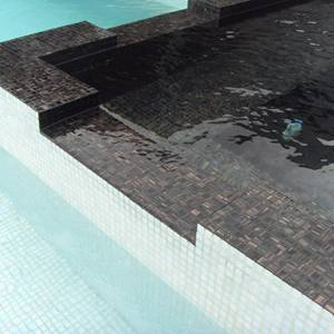GC099 Black Caramel mosaic tiles tiled this Spa pool