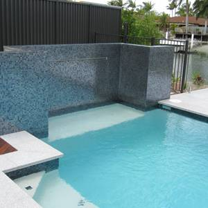 GC102 Charcoal Pearl Glass Mosaic tiles used as feature wall beside swimming pool