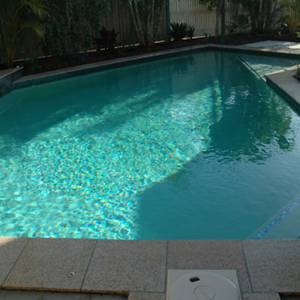 GC102 Charcoal Pearl glass mosaic pool tiles shown as waterline tiles