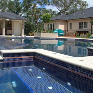 Pool and Spa tiled with GC125 Dark Blue Gold glass mosaic tiles showing deep blue water colour