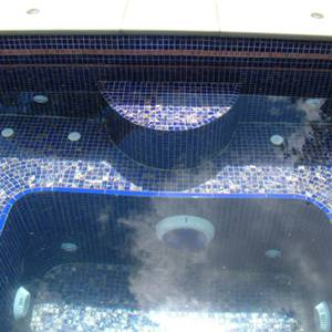 Spa interior tiled with GC125 Dark Blue Gold glass mosaic tiles