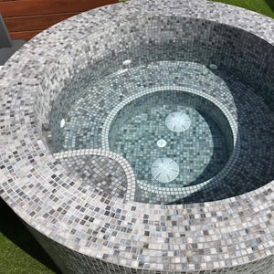 GC480 Tempest Glass mosaic tiles tiling a pools interior