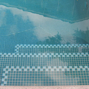GCR120 Green Crystal 23mm mosaic tiles shown tiling the inside of a swimming pool