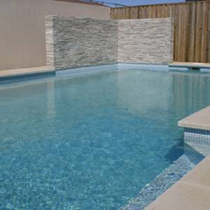 SS110 Frosted Ice Fine stacked stone cladding used as poolside feature wall